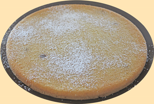 Bottom of cake sprinkled with icing sugar and dessicated coconut