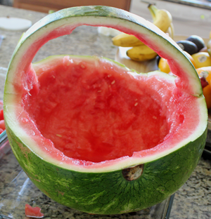 a view of the watermelon contents scooped leaving the shell of the watermelon
