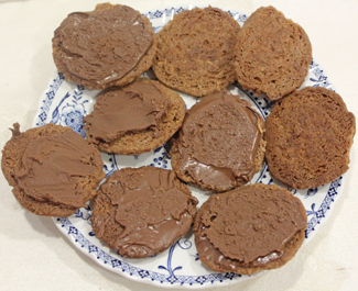 chocolate melted and applied to biscuits