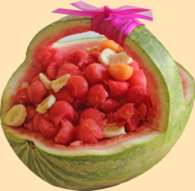 Watermelon shell filled with a mix of fruits