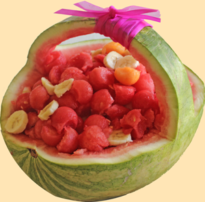 The watermelon basket filled with balls and slices of fruits